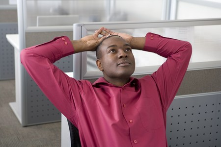 front desk: Businessman relaxing in office cubicle Stock Photo