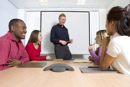 conference call: Co-workers in business meeting Stock Photo