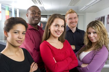 Multi-ethnic co-workers posing in office photo