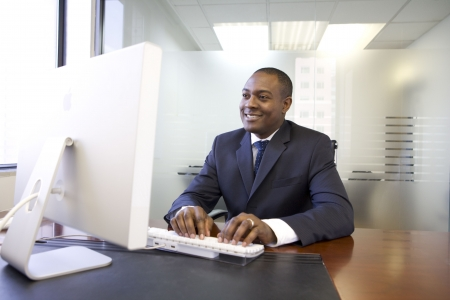 Businessman typing on computer keyboard Stock Photo - 4518462
