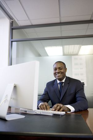 Businessman typing on computer keyboard photo