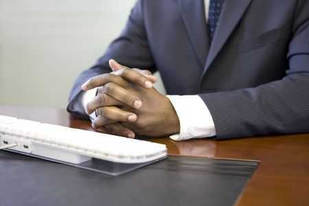 front desk: Close up of computer keyboard and businessman's hands