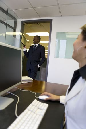 Businessman bringing file to co-worker photo
