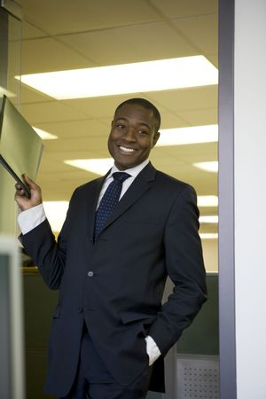 Businessman holding file photo