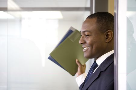 Businessman holding files photo