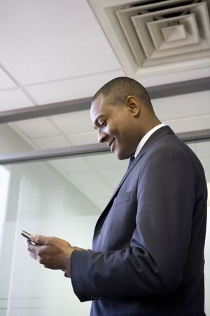 Businessman looking at cell phone Stock Photo