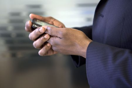 Close up of businessman looking at cell phone