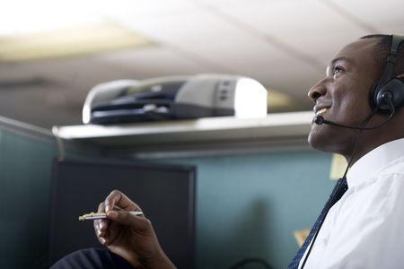 Businessman talking on headset photo