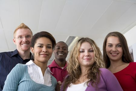 Co-workers posing in office photo