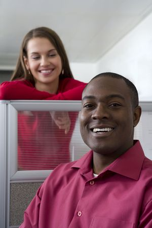 Businessman and co-worker in cubicles photo