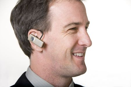 Businessman talking on cell phone earpiece Stock Photo