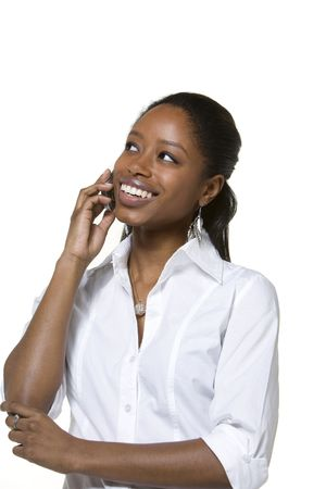 woman looking up: Portrait of businesswoman talking on cell phone Stock Photo