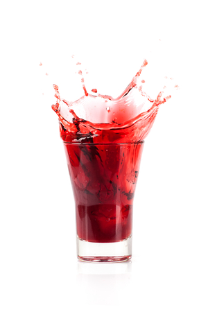 Glass of red grape juice with a splashes Stock Photo