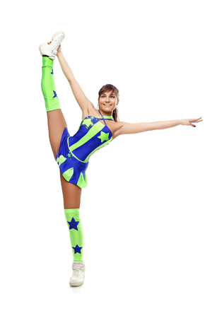 Dance girl on a splits. Pretty flexible stretch girl standing on white background photo