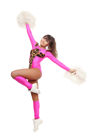 Cheerleader girl posing with pom-pom. Pretty flexible girl pink leo costume photo