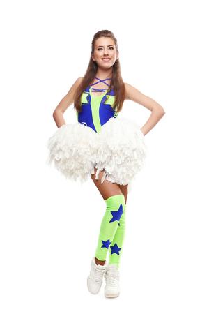pompom: Cheerleader ragazza con pom-pom sorridente. Giovane ragazza con pom su sfondo isolato Archivio Fotografico