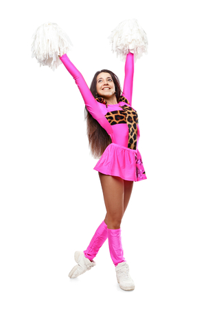 Cheerleader girl standing with pom-pom. Pretty flexible girl pink leo costume photo