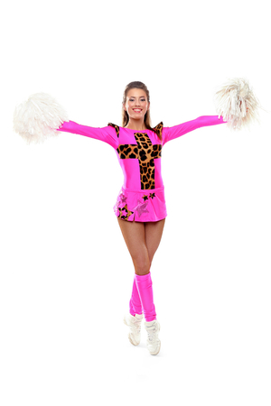 Cheerleader girl standing with pom-pom. Young fitness girl with pom on isolated background photo