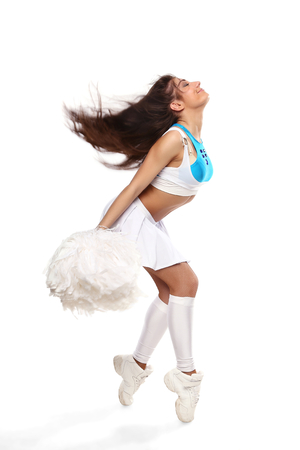 Cheerleader girl standing with pom-pom. Pretty flexible girl standing on white photo
