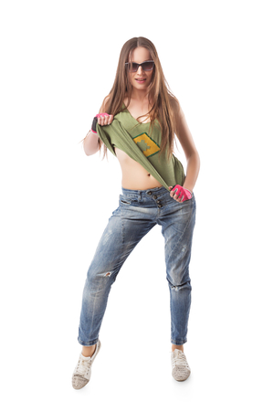 Modern hip-hop girl standing on isolated background. Young go-go dance girl isolated on white background photo