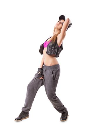 Modern urban girl standing on isolated background. Hip-hop go-go dance girl on white Stock Photo