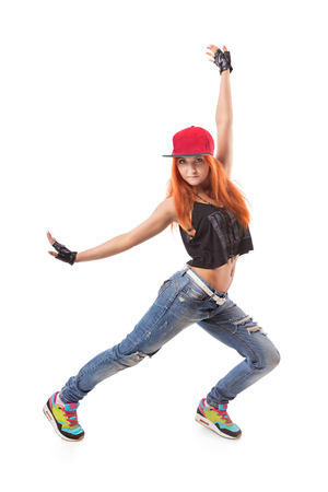 fingerless gloves: Modern hip-hop girl standing on isolated background. Young teenager with jeans. cap and fingerless gloves Stock Photo