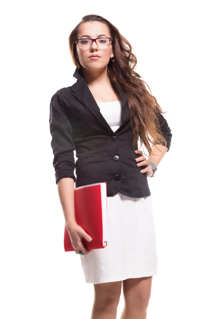 Business female standing with red document folder. Business female standing on isolated background photo