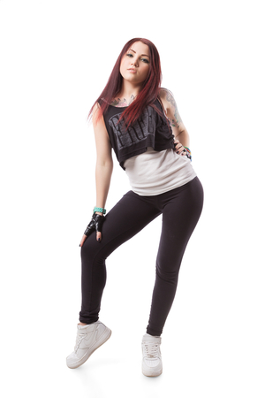 Female dance girl with fingerless gloves and tattoo isolated on white background.