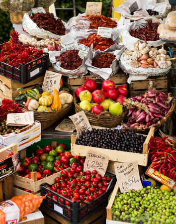 organic peppers sign: fruit and vegetable open air market in Italy