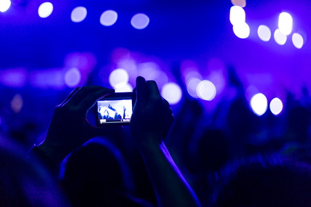 rock concert with smartphone Stock Photo