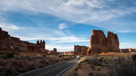 View in Arches National Park viewing the desert landscape of the Three Sisters, Tower of Babel, and The Organ.