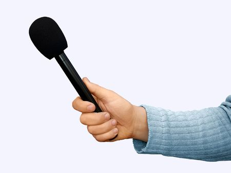 wireles: Hand with a professional handheld microphone