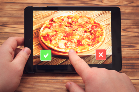 Pizza online order with tablet pc. Or choose item.