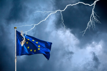 The European Union suffers from a crisis, visualised by the European flag struck by lightning during a storm Stock Photo