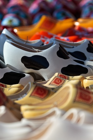 Different styled wooden clogs for sale at a Dutch tourist market Stock Photo - 13567612