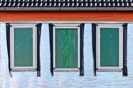 Thermal insulation on the wall of a new build house Stock Photo - 13930077