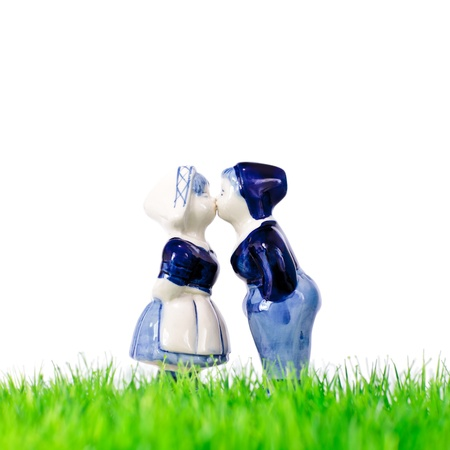 Dutch souvenir boy and girl kissing on grass photo