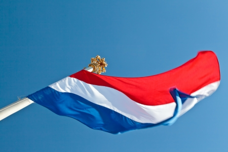 dutch flag: Dutch national flag at Paleis het Loo, the Royal Palace in Apeldoorn, The Netherlands