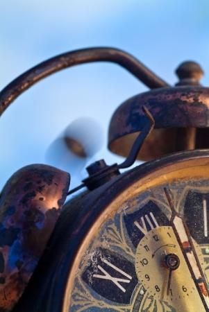 Vintage alarm clock ringing on a blue background