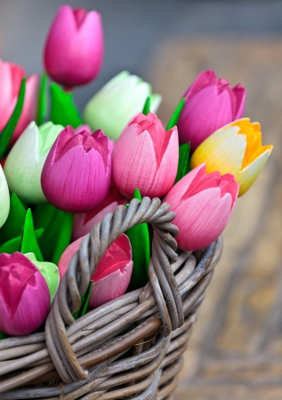 made in netherlands: Colorful assortment of wooden tulips in a basket Stock Photo