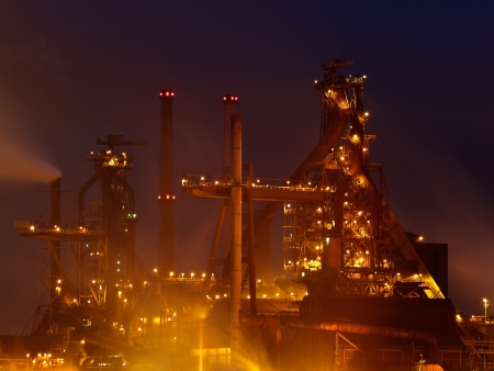 View of a large factory after sunset in The Netherlands photo