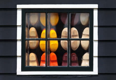 Wooden souvenir clogs behind a window of an old Dutch house at the Zaanse Schans Stock Photo - 14348892