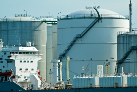 petroleum: Oil tanker in front of oil station exchanging cargo