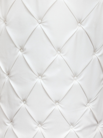 White leather texture with buttons in a pattern
