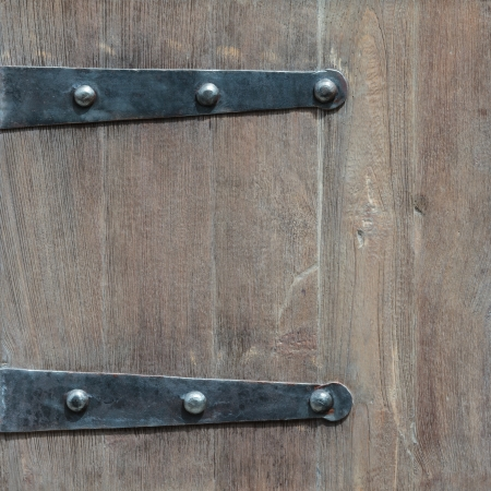 Detail of an old wooden door with metal hinges Stock Photo - 14883459