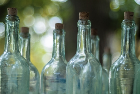 antiquary: Old empty bottles on an outdoor antique market Stock Photo