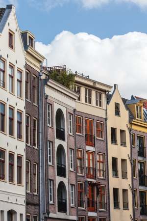 monument historical monument: Row of old historic and modern designed canal houses in Amsterdam Editorial
