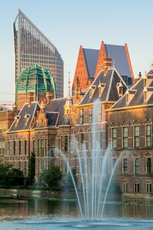 View with fountain at the Dutch parliament buildings in The Hague during sunset