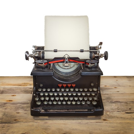 Old Dutch typewriter on a vintage wooden floor isolated on white Imagens