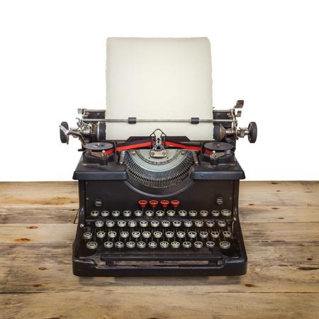 Oude Nederlandse schrijfmachine op een vintage houten vloer geïsoleerd op wit Stockfoto